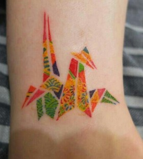 Colorful simple origami tattoo on leg