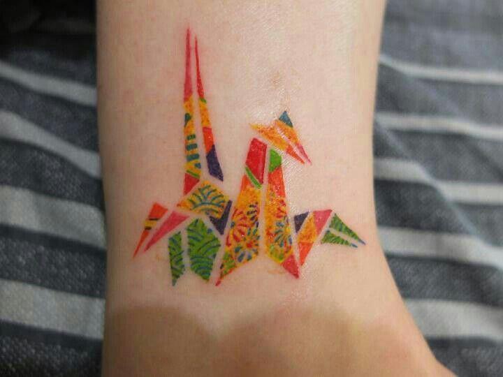Colorful simple origami tattoo on leg