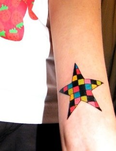 Colorful square star tattoo on arm