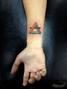 Colorful triangle tattoo