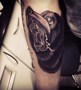 Cool black bear tattoo on arm