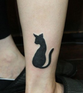 Cool black cat tattoo on leg