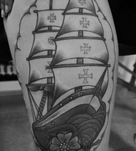 Cool black ship tattoo on leg
