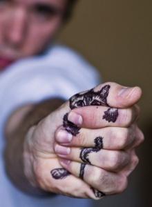 Cool cat tattoo on palm