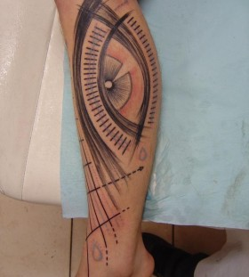 Cool design of eye tattoo on leg