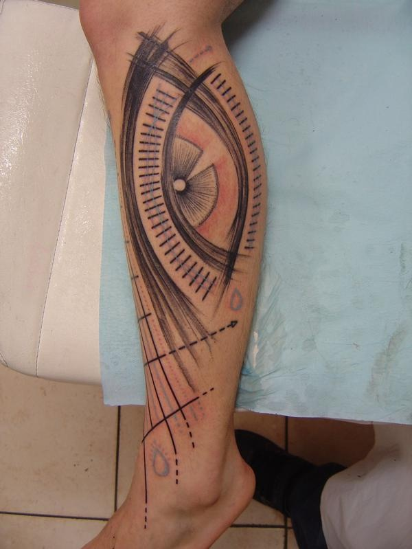 Cool design of eye tattoo on leg