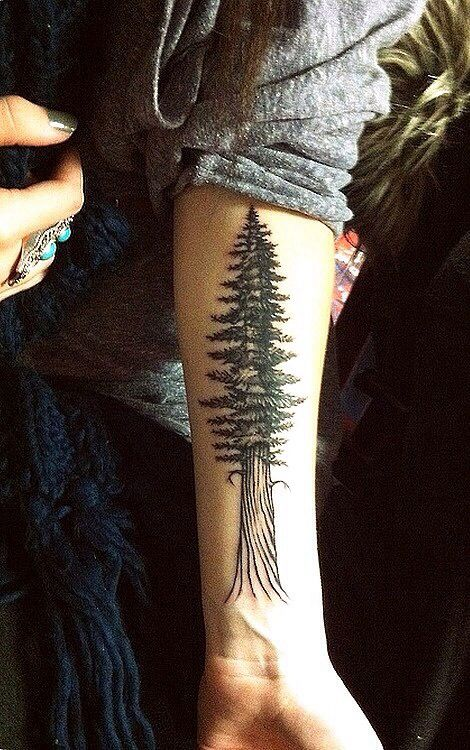 Cool girl's tree tattoo on arm