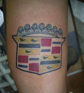 Crown and bird car tattoo on leg
