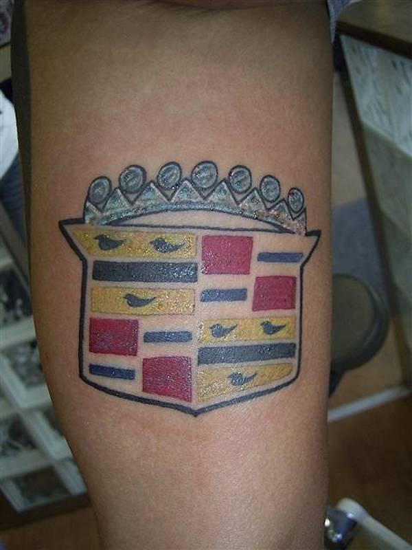 Crown and bird car tattoo on leg