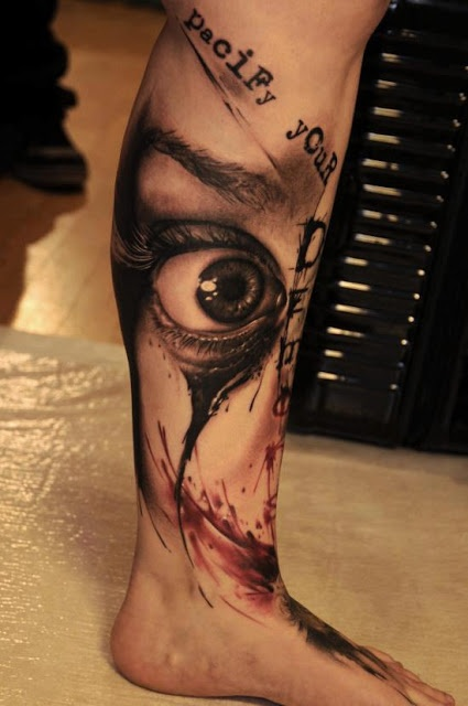 Cruel men's eye tattoo on leg