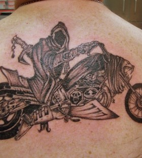 Crule black bicycle tattoo on back