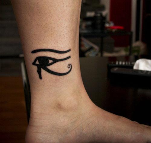 Crying black eye tattoo on leg