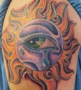 Crying colorful eye tattoo on shoulder