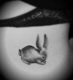Cute and shye rabbit tattoo on body