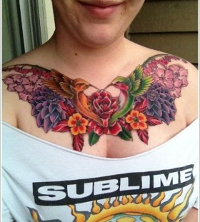Cute birds and colorful flower tattoo on chest