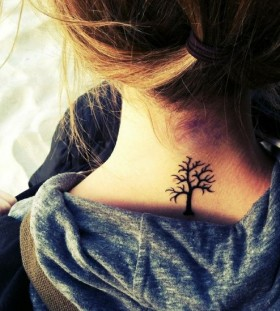 Cute black tree tattoo on shoulder