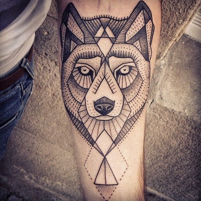 Cute black wolf tattoo on arm