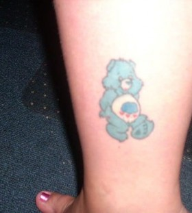 Cute blue bear tattoo on leg