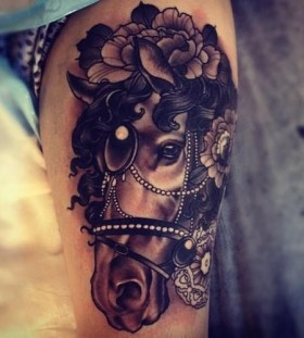 Cute brown horse tattoo on arm