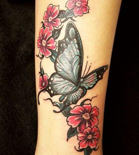 Cute butterfly and flower tattoo on hand