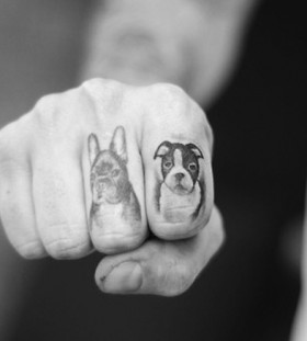 Cute dogs tattoo on finger