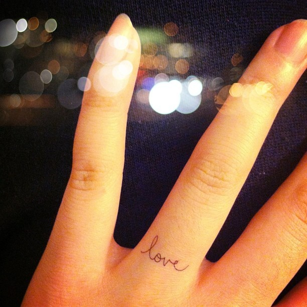 Cute finger love tattoo on arm