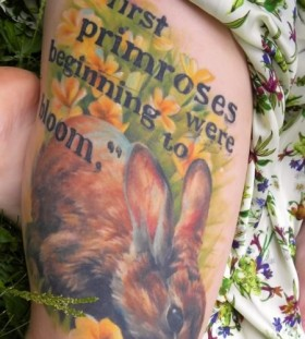 Cute flowers rabbit tattoo on body