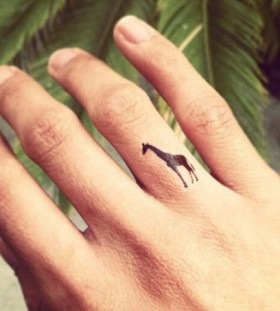 Cute giraffer tattoo on finger