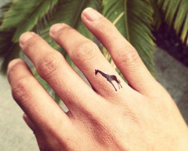 Cute giraffer tattoo on finger