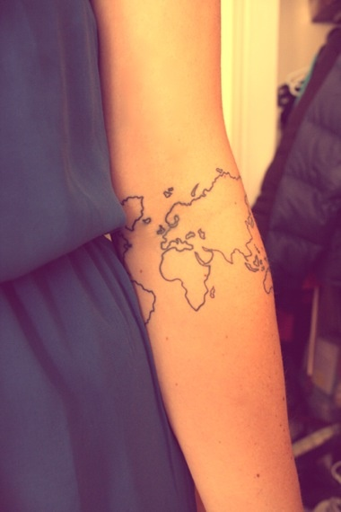 Cute girl map tattoo on arm