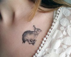 Cute girl rabbit tattoo on body
