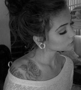 Cute girl rose tattoo on shoulder