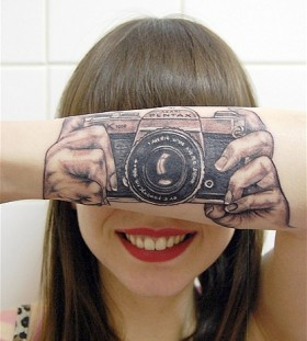 Cute girl smile camera tattoo on arm