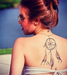 Cute girl with dream catcher tattoo