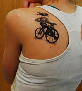 Cute girl's bicycle tattoo on back