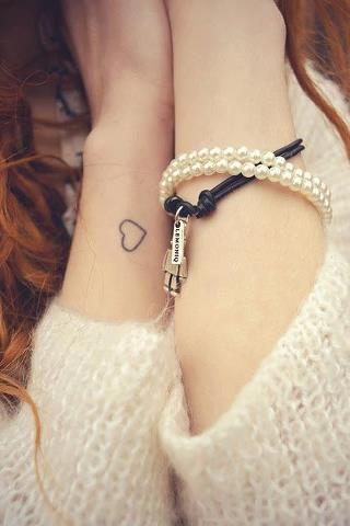 Cute girl's heart tattoo