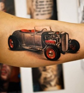 Cute red and black car tattoo on arm