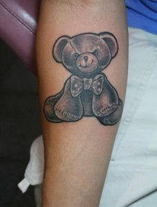 Cute simple bear tattoo on arm