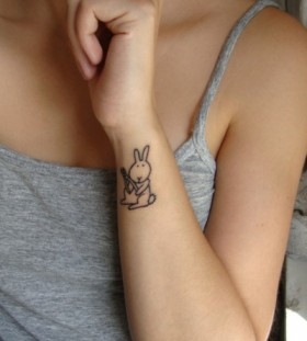 Cute simple rabbit tattoo on body