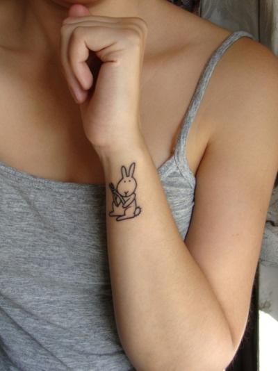 Cute simple rabbit tattoo on body