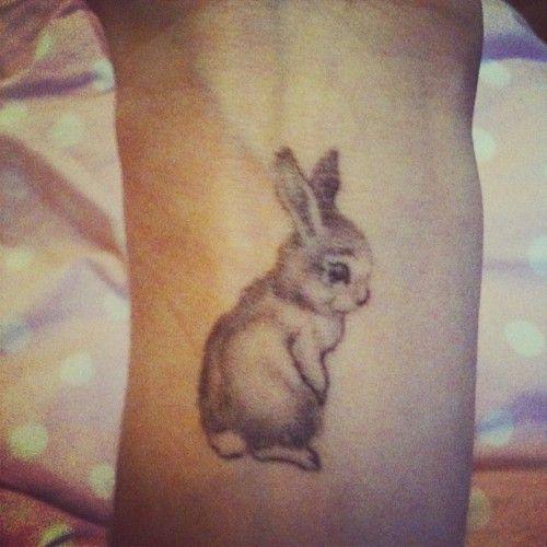 Cute small rabbit tattoo on arm