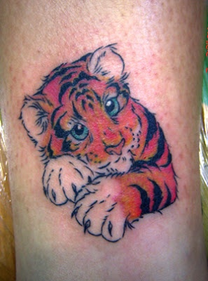 Cute small tiger tattoo on leg
