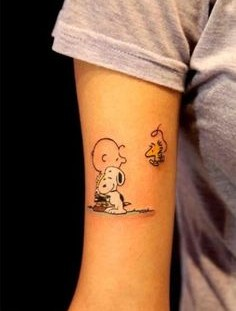 Cute snoopy tattoo on arm