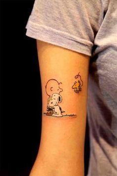 Cute snoopy tattoo on arm
