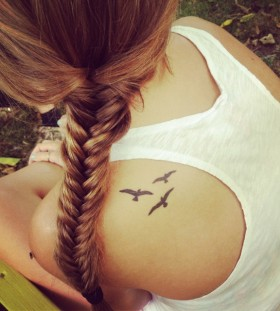 Cute women bird tattoo on shoulder