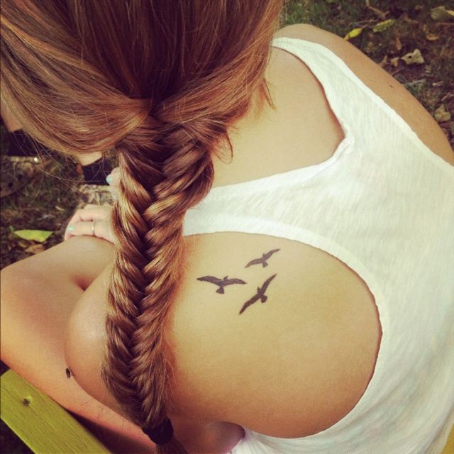 Cute women bird tattoo on shoulder