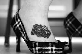 Cute women highheels and camera tattoo on leg