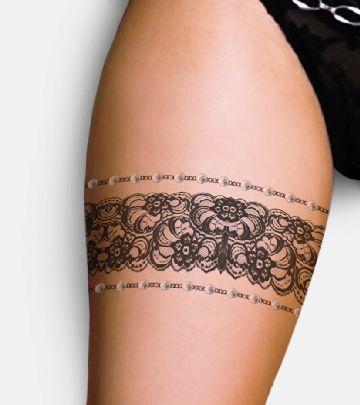 Cute women's lace tattoo on leg