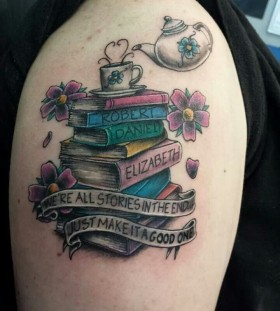 Different names and book tattoo on arm
