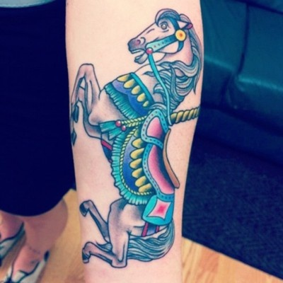 Elegant and colorful horse tattoo on arm